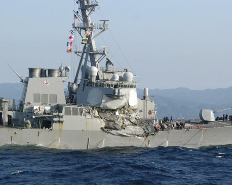 Search on for 7 Navy crew after ship damaged in collision