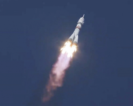 Russian-US crew launches on fast track to the space station