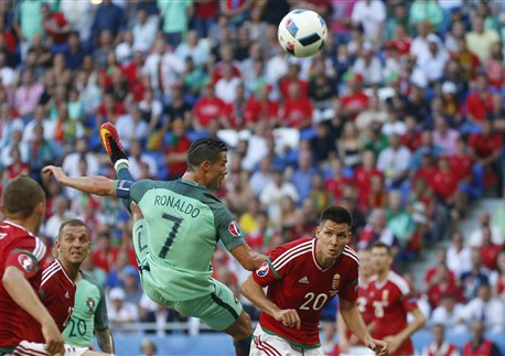 Portugal and Hungary advance,  after thrilling 3-3 draw