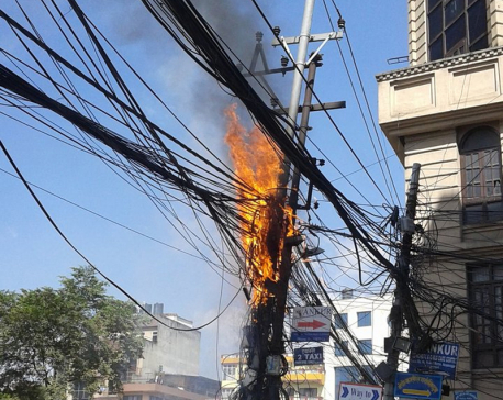 Electric pole catches fire, contained