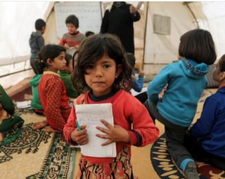 Having fled bombing, Syrian children learn to read in borderland tent schools