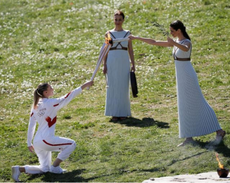 Tokyo 2020 torch lit behind closed doors in ancient Olympia