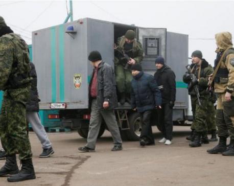 Ukraine begins all-for-all prisoner swap with separatists
