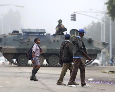Zimbabwe army has Mugabe, wife in custody, controls capital