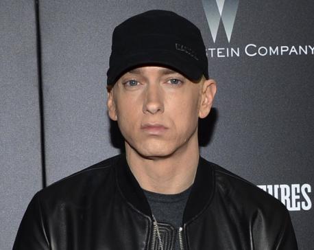 Eminem drops surprise album, advocates changes to gun laws