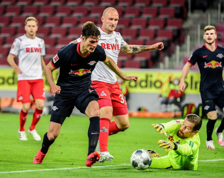 Soccer-Leipzig move into third spot with 4-2 win at Cologne