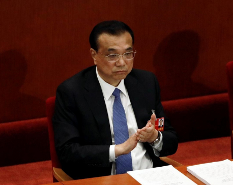China's economy recovering but hard battle ahead: premier
