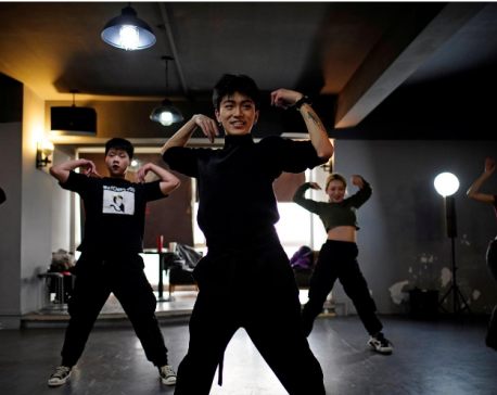 Wuhan's vogue dancers embrace new freedom as COVID-19 anniversary nears