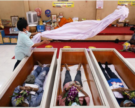 Thais seek to restore fortunes with mock funerals