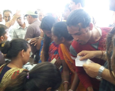 Voters line up for voter identity card