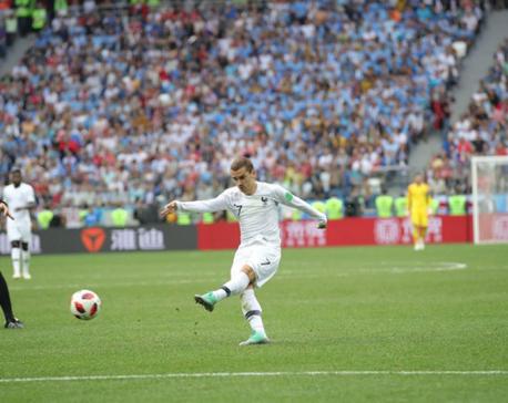 Griezmann inspires France past punchless Uruguay