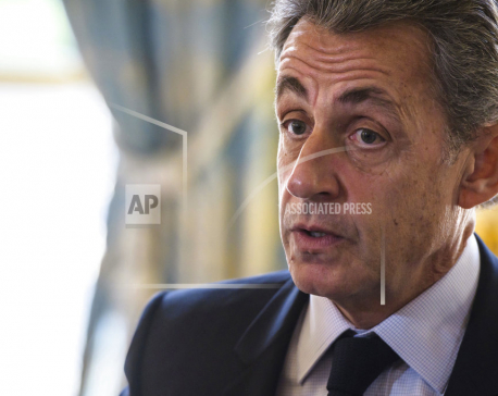 Ex-French president Sarkozy held on Gadhafi claims - source