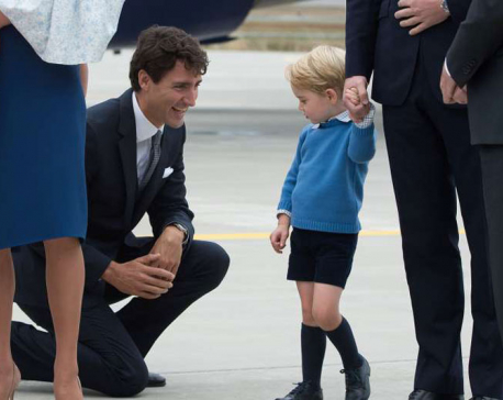Young Prince George shuns high-five from Canadian PM