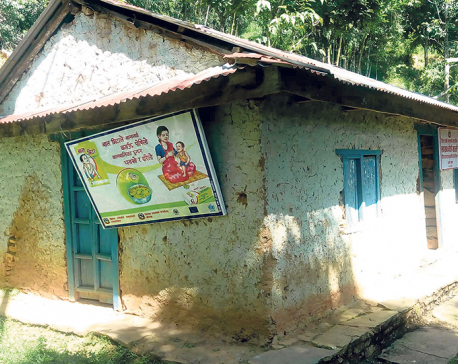 Health workers providing treatment under leaking roof