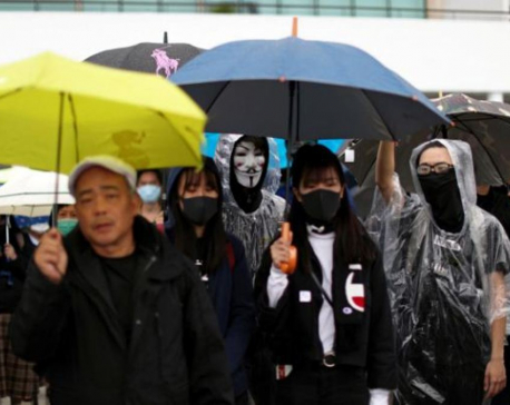 More than 1,000 gather for rain-soaked Hong Kong rally