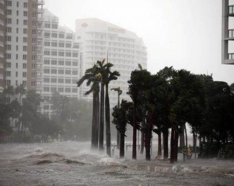 Weakening but still potent Irma aims full force at Florida's Gulf Coast