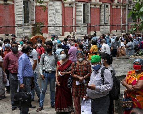 India's virus cases decline, but WHO expert says positive tests ominously high