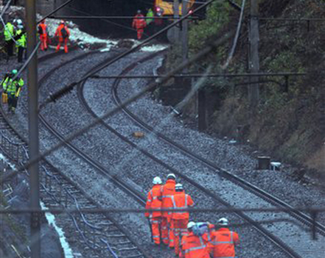 Train derails after heavy thunderstorms pound England