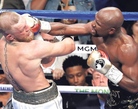 Mayweather silences McGregor with 10th round TKO