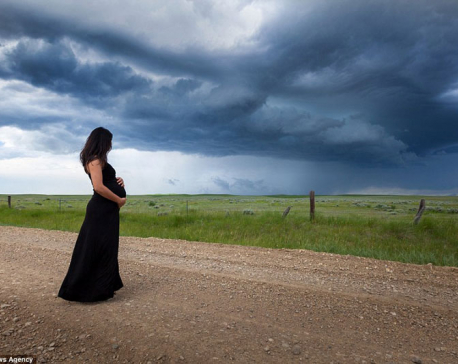 Mother-to-be poses in the middle of dramatic storms