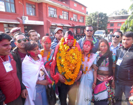 Flanked by wives, Narad Muni Rana celebrates victory