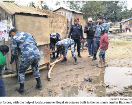 Security forces dismantle huts built along no-man's land