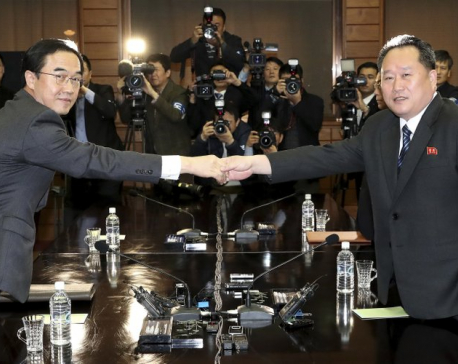Rival Koreas begin high-level talks meant to set up summit