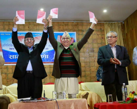 Dahal, Oli can't contain their smiles