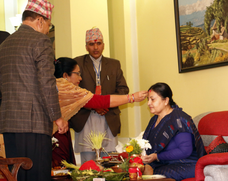 President Bhandari receives Dashain tika ( Photo Feature)
