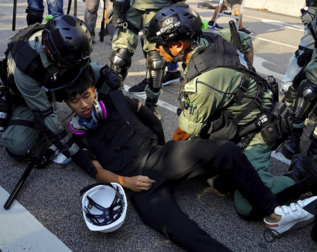 Hong Kong protesters burn flag, police fire pepper spray