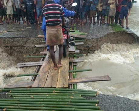 Flood sweeps away Rangeli-Urlabari Highway