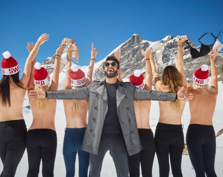 Ranveer Singh strikes a pose with topless girls