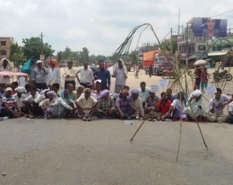 Sugarcane farmers block East-West Highway demanding to clear due