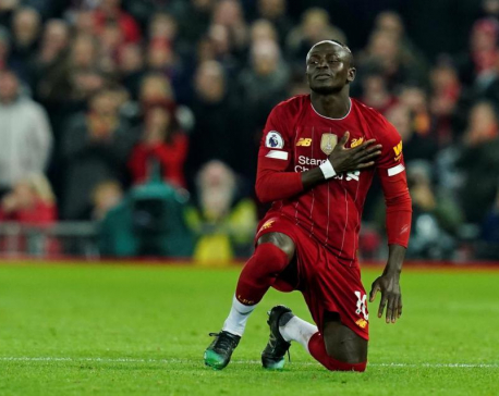 Controversial Mane goal gets Liverpool past battling Wolves