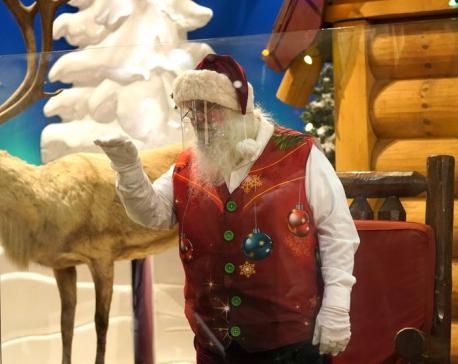 Ho, ho — Whoa! Virus keeping most Santas at a distance