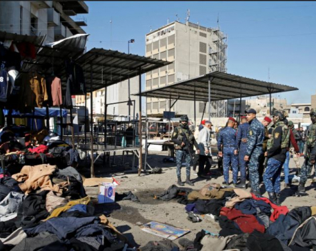 Rare twin suicide attack kills at least 23 in Baghdad
