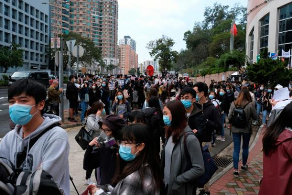 Hong Kong records first virus death, Macau shuts casinos