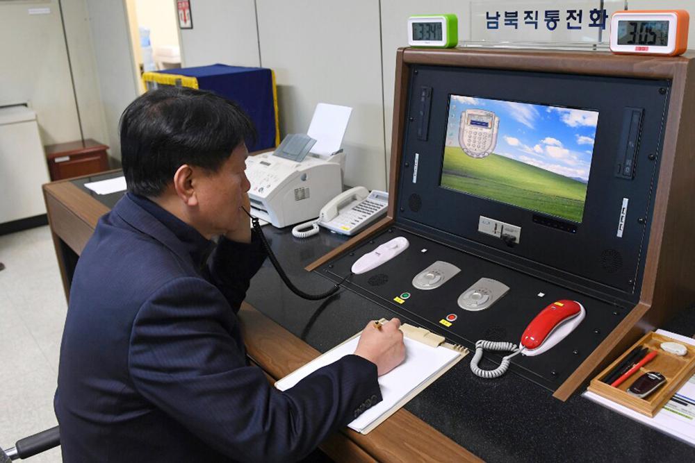 2 Koreas restore hotline despite North's missile tests