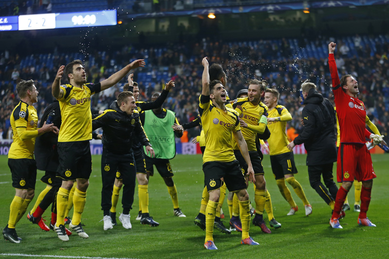 Dortmund holds Madrid 2-2 to win group, break scoring record