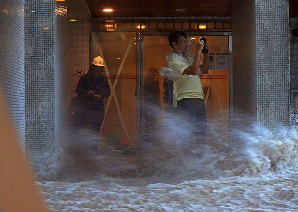 16 dead as strong typhoon floods Macau, southern China