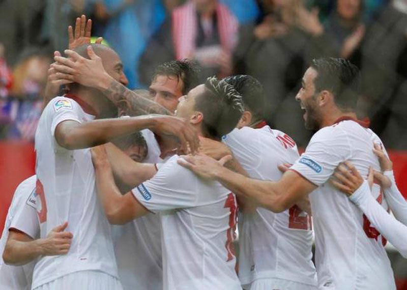 Impressive Sevilla hands Atletico its 1st loss in Spain