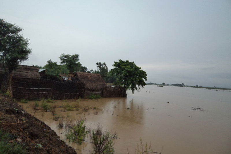 Locals cautioned as water level surges in Rapti River