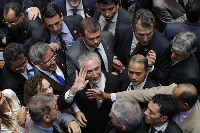 Brazil's Michel Temer inherits presidency on shaky ground