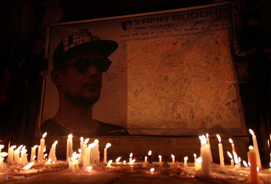 Candles lit to commemorate rapper Yama Buddha  (photo feature)
