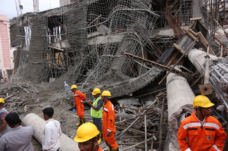 8 die as portion of building collapses in India