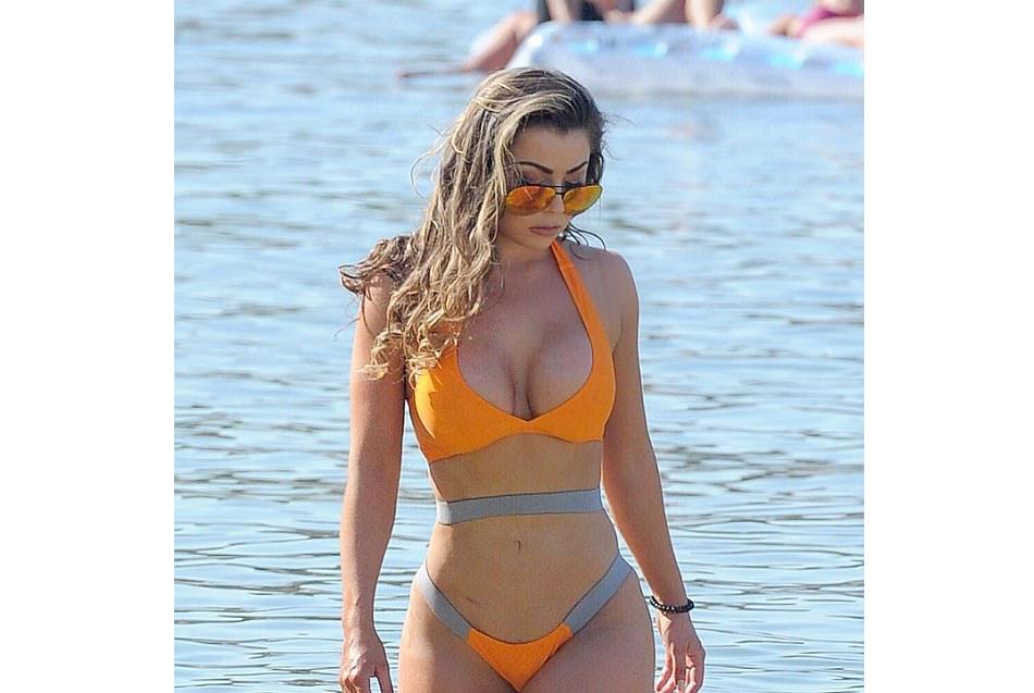 Busty Abigail Clarke flaunts her recent bum lift in sizzling orange bikini