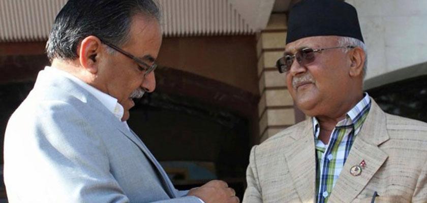 Dahal calls on PM Oli at Baluwatar