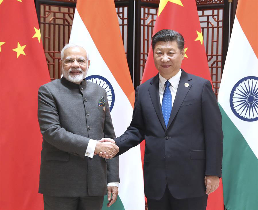 China urges India to view its development from an objective perspective