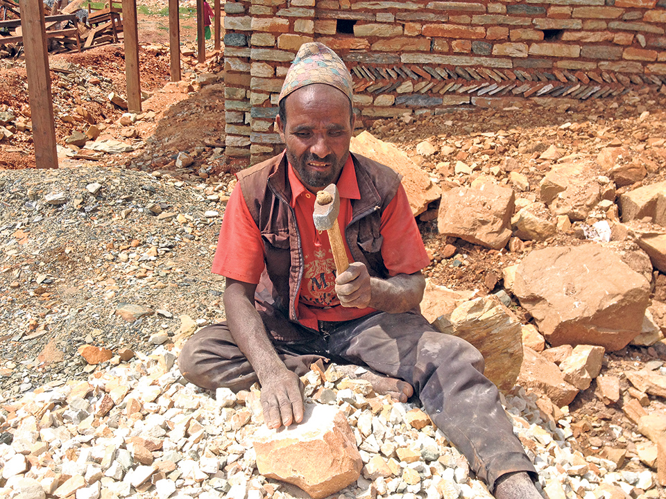 Visually impaired man feeds his family by grinding stones