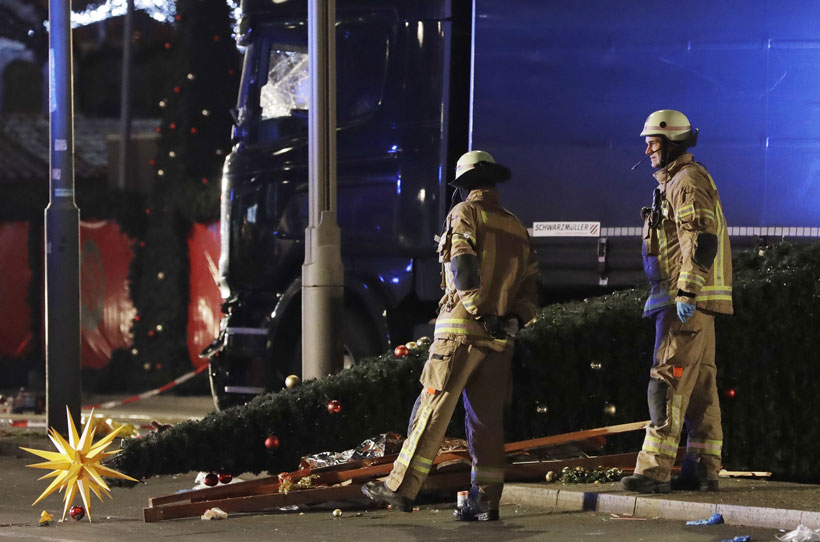 Truck rams into German Christmas market, killing 12 people